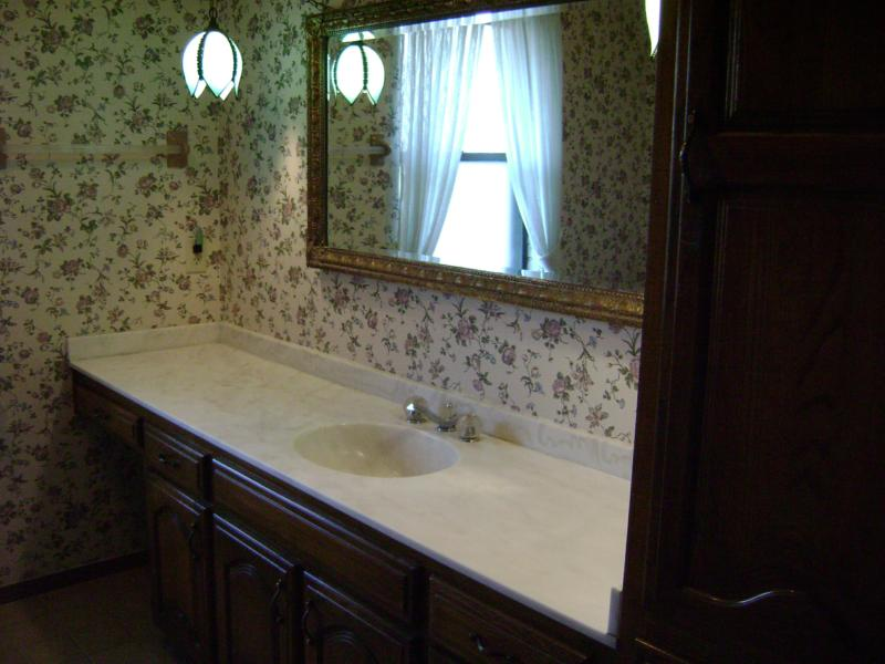 bathroom with wallpaper in Owasso, Oklahoma