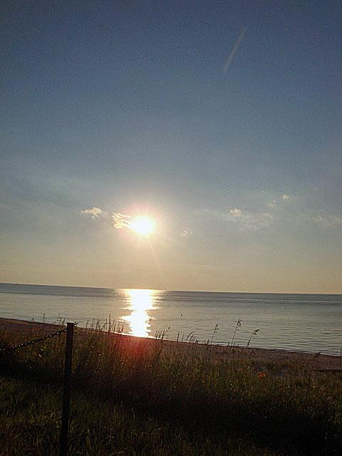 Take a drive along Lake Shore Drive in Long Beach Indiana to see some awesome Summer Sunsets over Lake Michigan