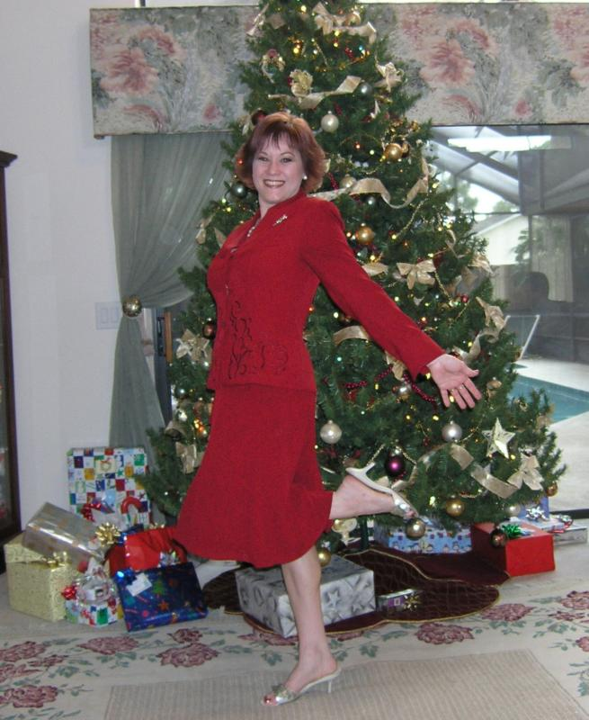 Lisa Hill posing in front of Christmas tree