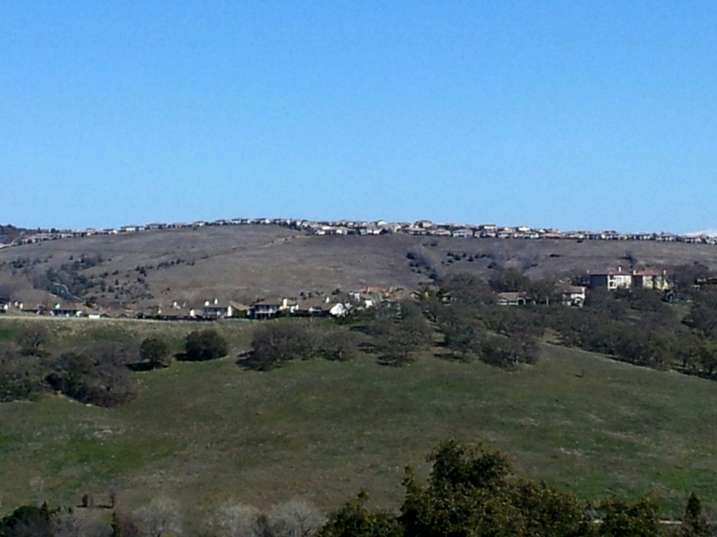 View from Ridgeview looking east seeing Serrano homes on ridge top