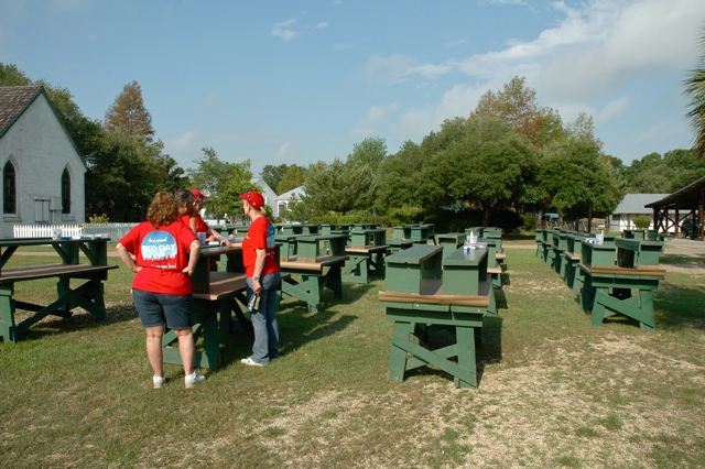 Row of benches painted by Keller Williams Realty Acadiana