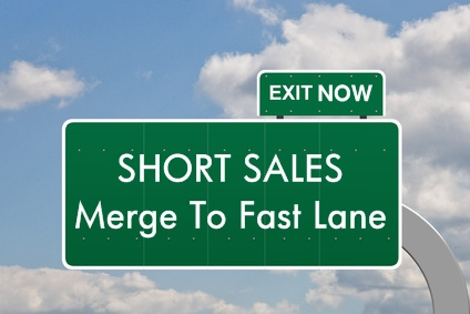 Short Sale Highway Sign That Reads Short Sales Merge to Fast Lane Exit Now