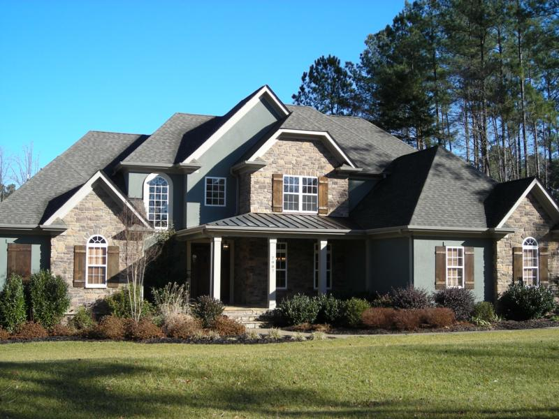 Stunning custom built french country stone and hard stucco for Stone french country homes