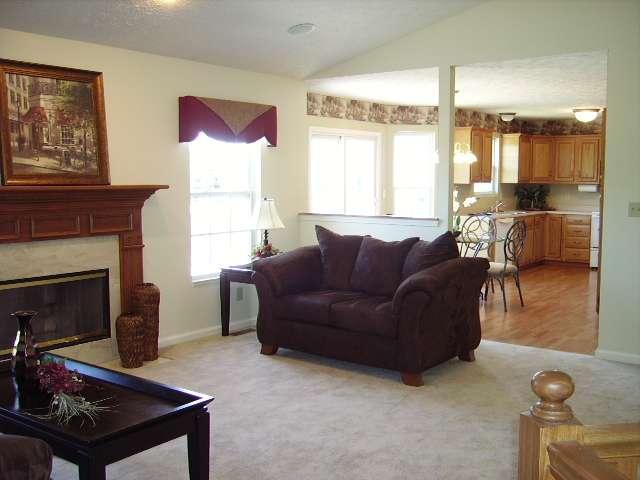 West Lafayette 3/4 bedroom home by Purdue Research Park, Burnett's Creek School, Chemtura, Purdue University with finished basement, vaulted living/great room with fireplace, 2 car garage, and deck listed for sale by West Lafayette Realtor, real estate agent Sharon Walter Keller Williams Realty Lafayette, IN 47905, 47906, 47909.