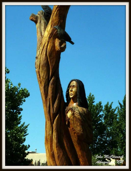 Carving of Woman Hugging Tree