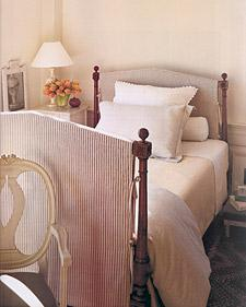 bed with slipcovered head and footboards