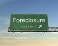 Green foreclosure interstate exit sign