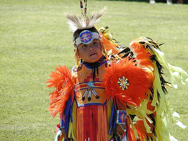 Boy in orange at Pechanga Pow Wow, Temecula CA