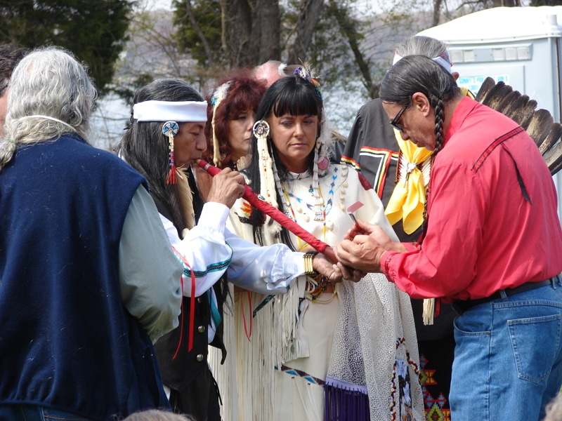Groom Smoking Peace Pipe At Native American Wedding Ceremony