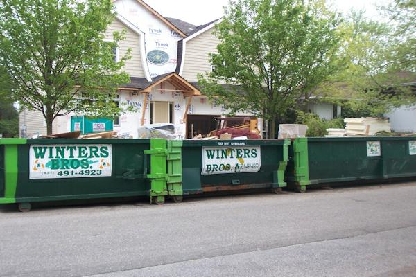3 dumpsters at 53 Mellow Ln