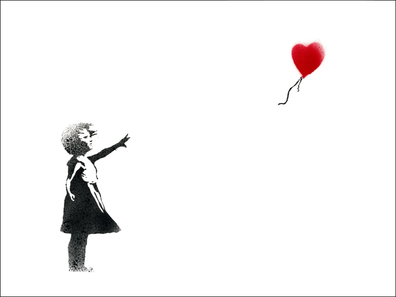 small girl with hearth shaped balloon