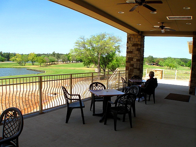 elkins lake clubhouse balcony overlooks golf and water, mari montgomery broker associate, real estate huntsville tx, homes for sale