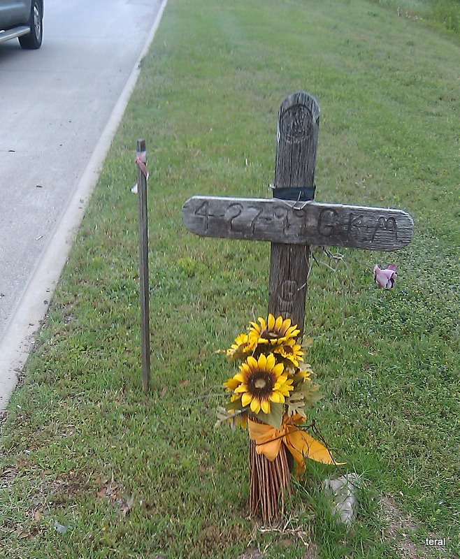 Photograph of a cross located along the roadway