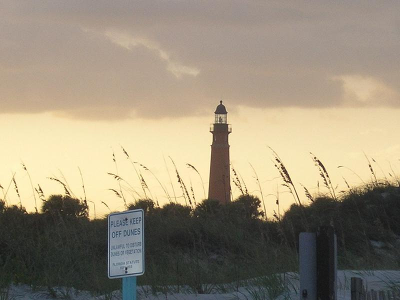 sunset at Ponce Inlet FL lighthouse and dunes