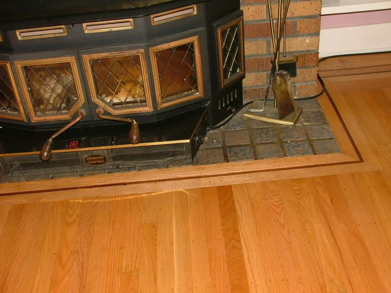how to install hardwood flooring around a fireplace hearth