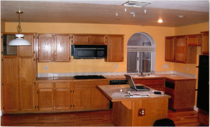 Yellow Oak cabinets and tile countertops