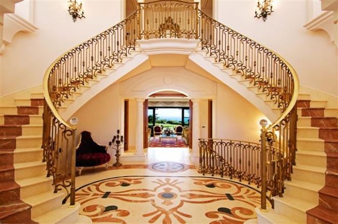 The grand entrance - double staircase enhances the overall grandeur of    Grand Double Staircase