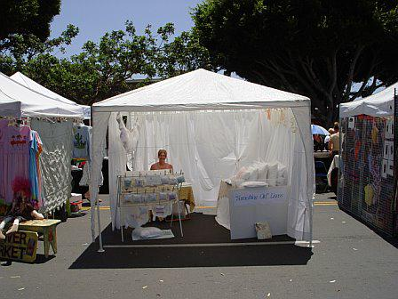 During what time of year is the Carlsbad Village Faire in California held?