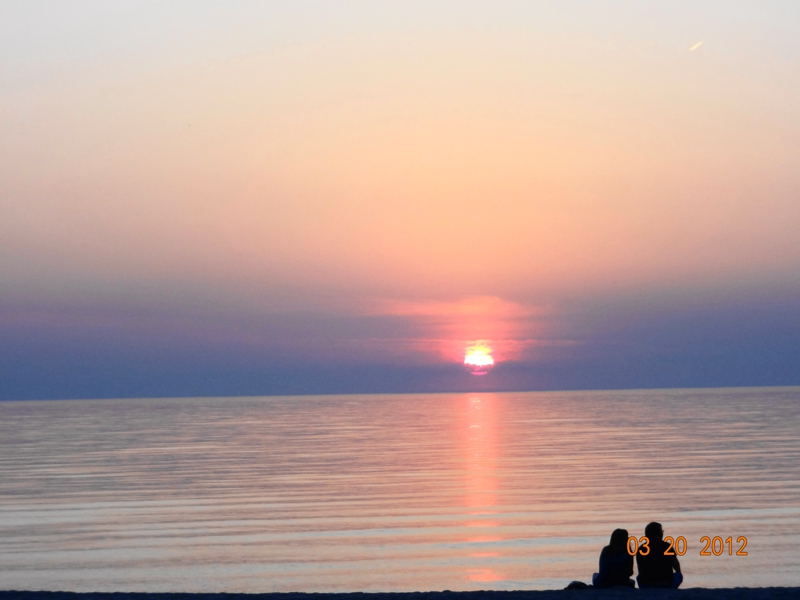 Oval Beach sunset in March 2012 courtesy of Dee Dee Hanson, CB Woodland Schmidt, Saugatuck