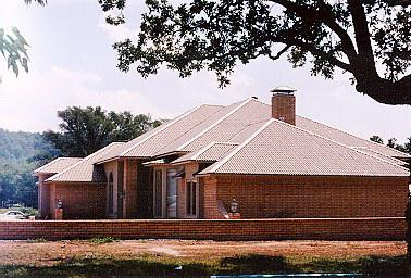 This Is A House With An Ondura Roof.