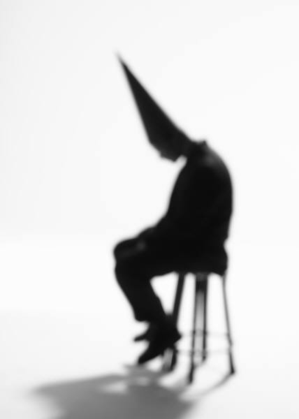 Picture of man in dunce cap
