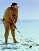 Man in Bikin Golfing