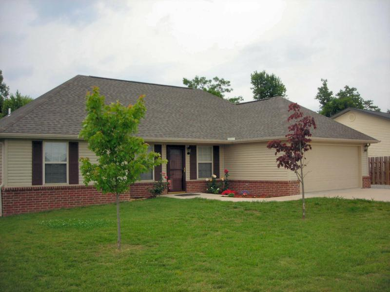 3 bedroom house, grass, trees, rose bushes