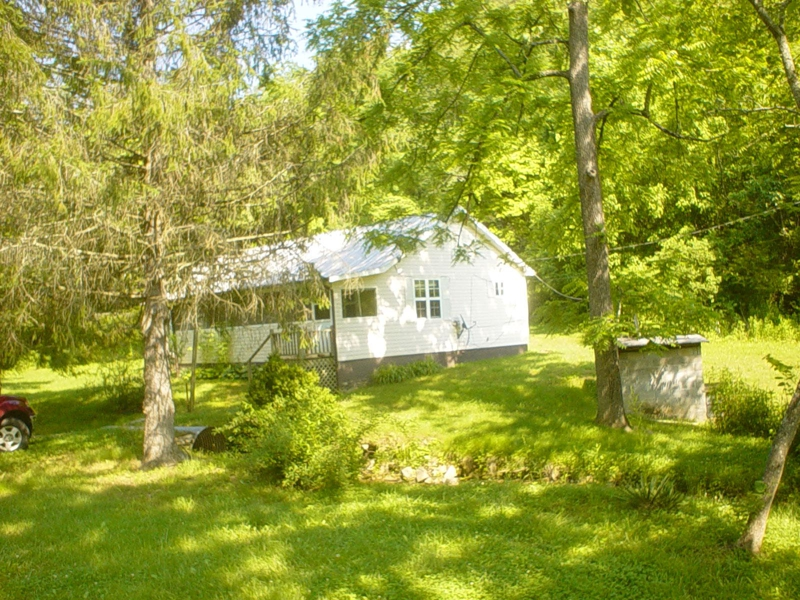 30 66 acres in Murphy, NC with Older 2BR/1BA Farm House For