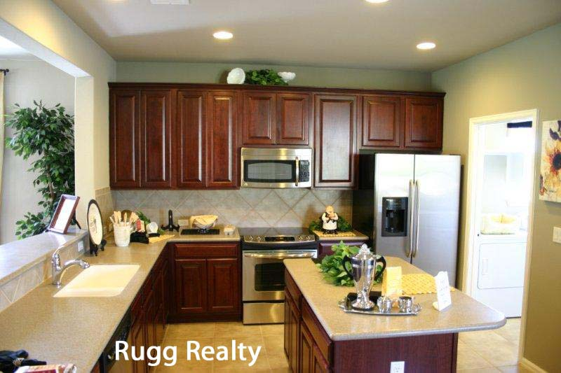 Sun city texas new homes for sale surrey crest model home for Model home kitchens