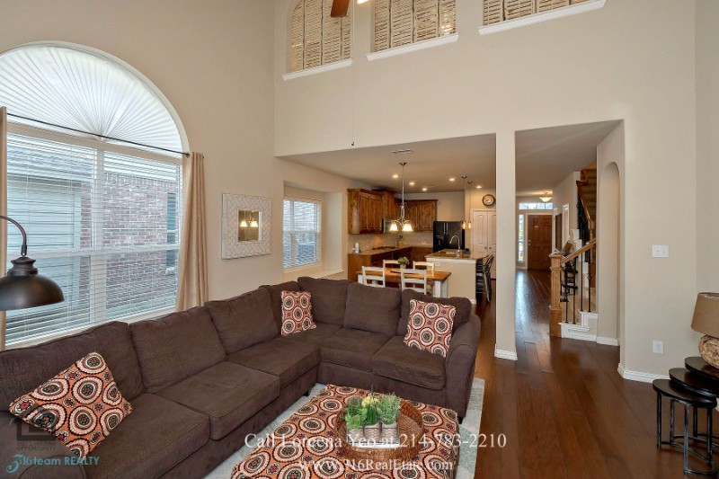 Homes for Sale in Little Elm TX - Welcome guests in the bright and airy family room of this Little Elm home.
