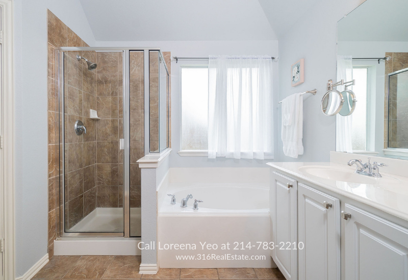 Little Elm TX  Homes- The ensuite bath of this Little Elm TX home offers the best of pampering and relaxation.