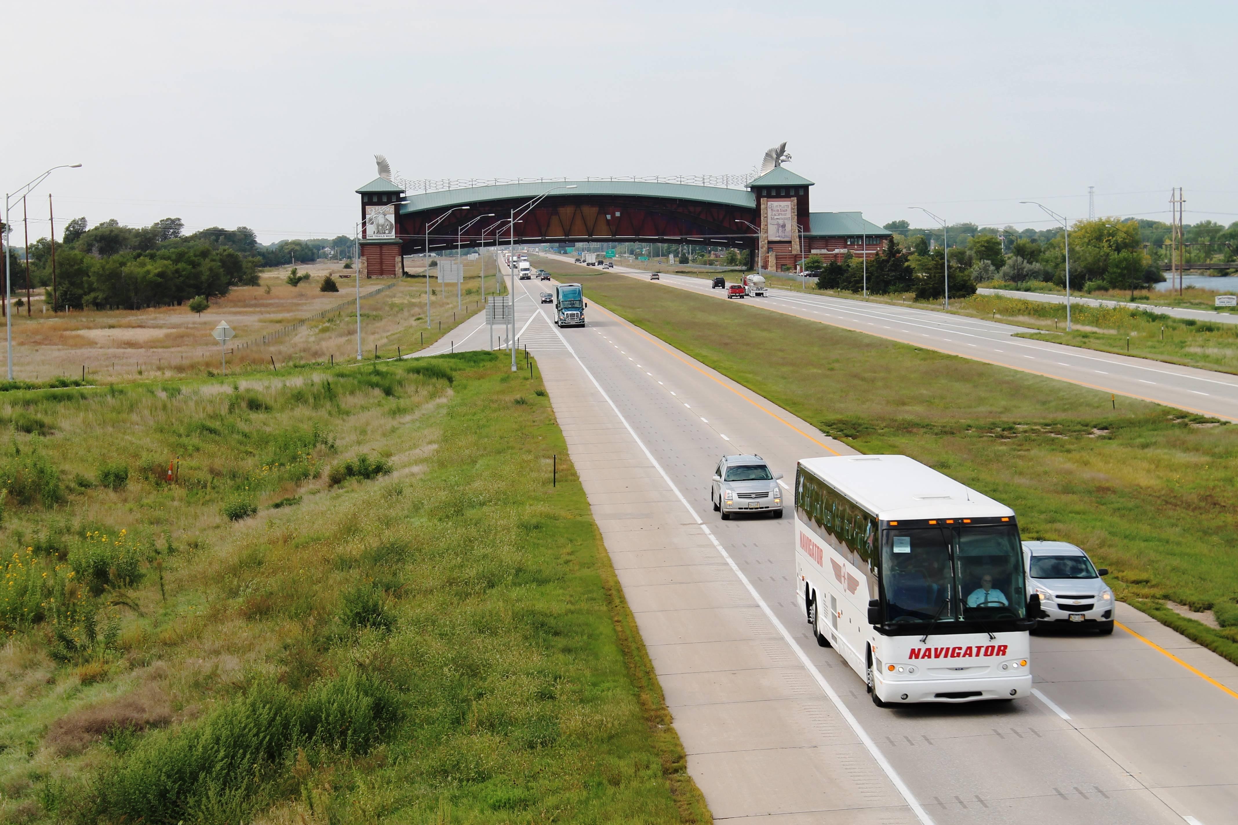 Mike McCann Nebraska Land Broker Korean War Vets on I-80 headed to DC 2014c