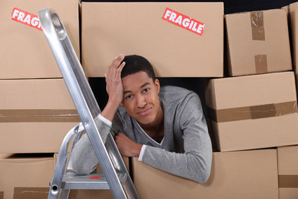 young man with packing boxes