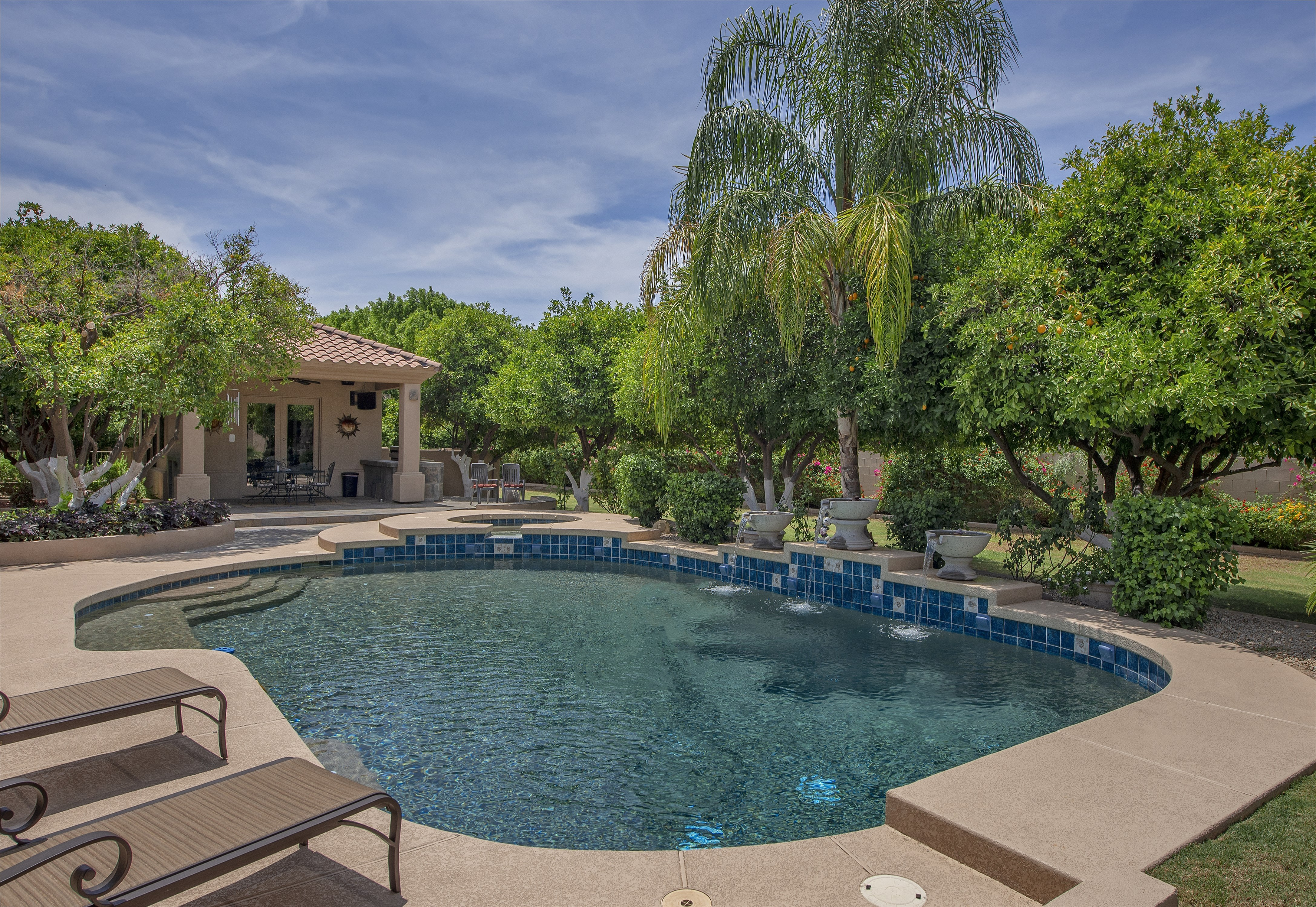 Living at its Finest! Nestled in the Orange Groves of Mesa