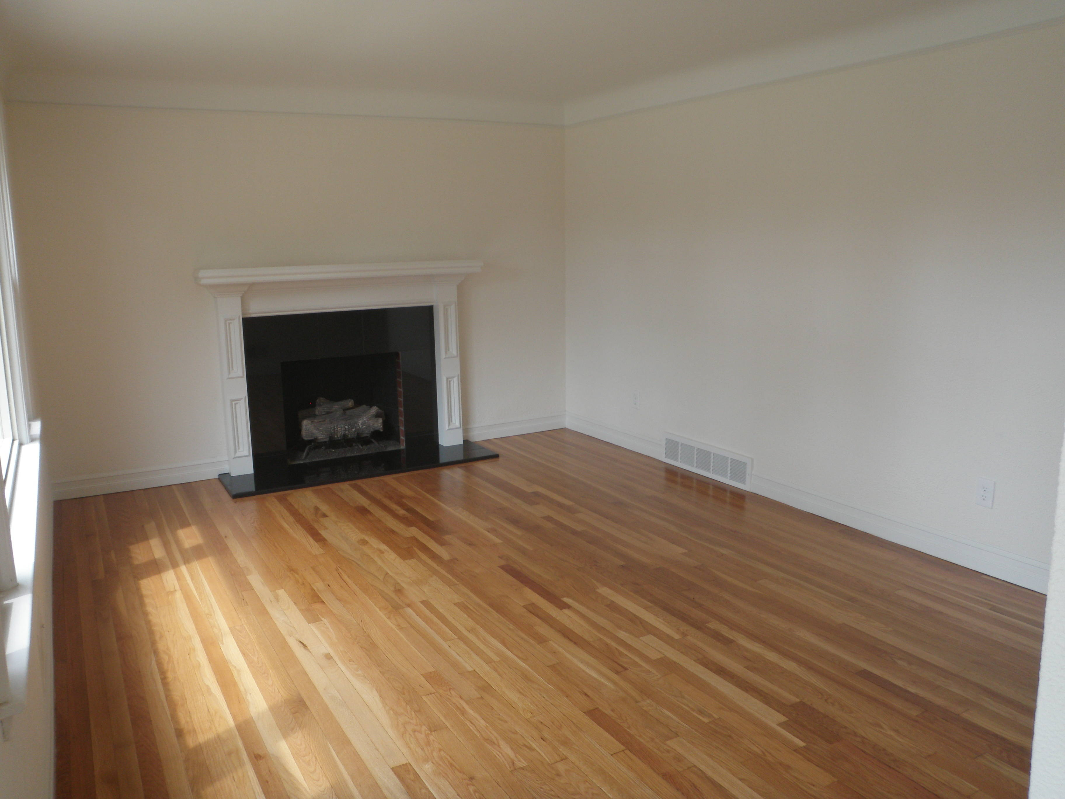 redone wood floor with fireplace