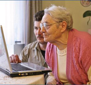 woman senior at computer