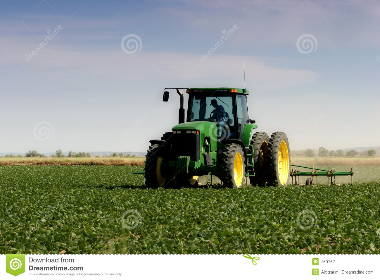 Farmer plowing fields