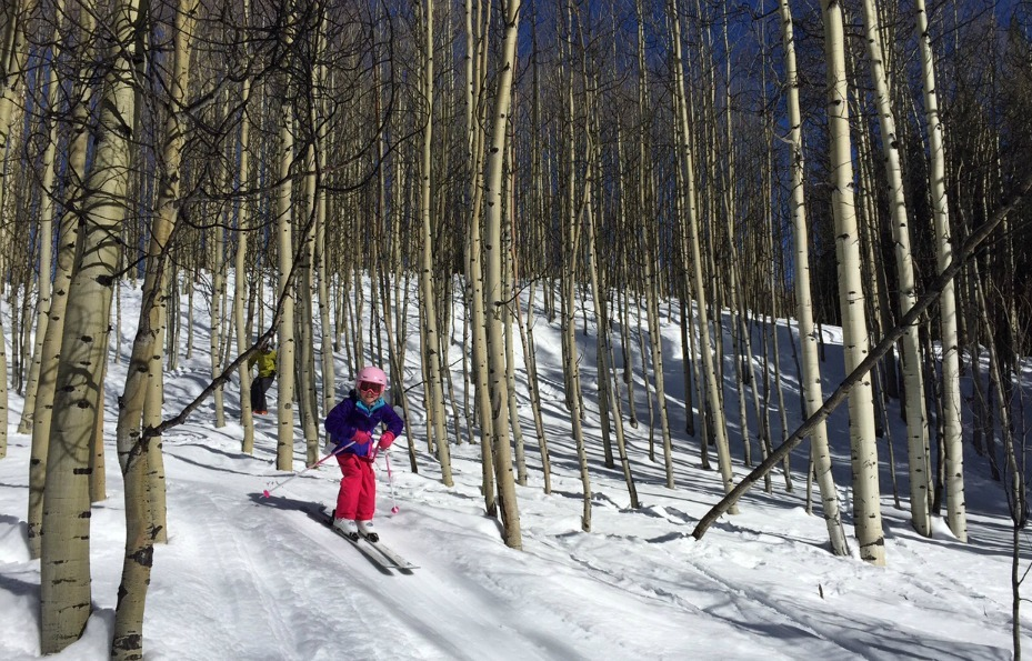 Kids ski through the aspens at Crested Butte.