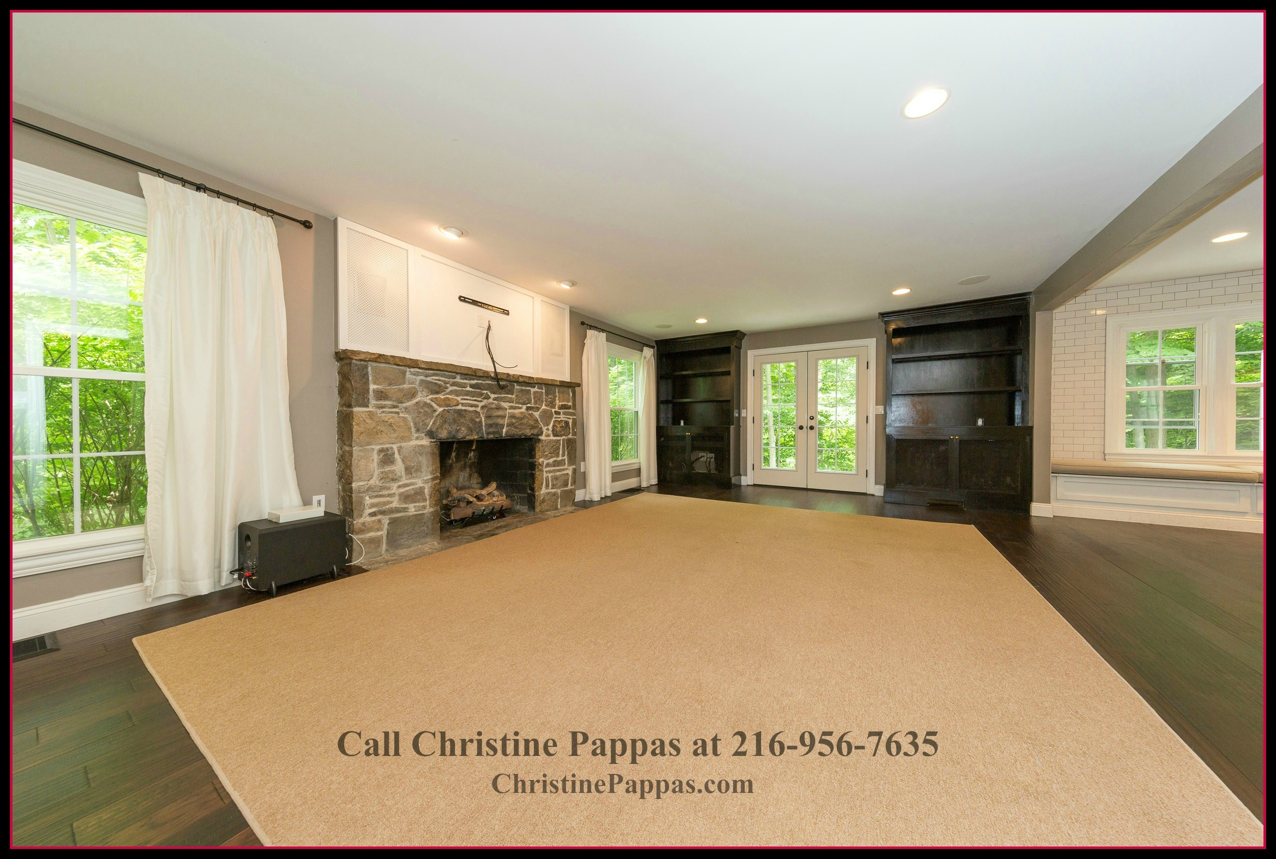 The formal living room of this Gates Mills OH home for sale, boasts of an open floor plan creating an expansive space.