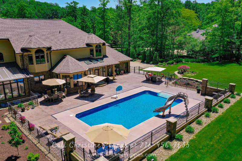Concord Township OH Luxury Homes- Indulge in this Concord Township OH luxury home's stunning in-ground pool.