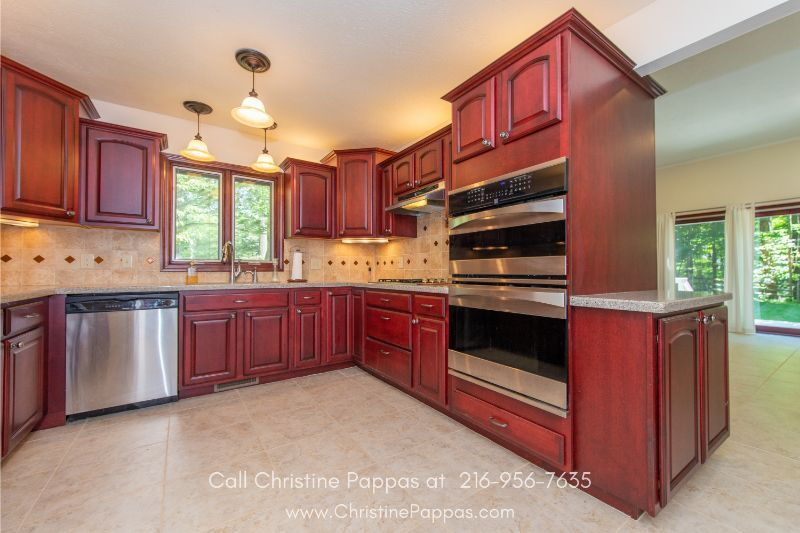 Homes for Sale in Novelty OH - Create mouthwatering dishes in the impressive hearth style kitchen of Novelty OH home for sale.