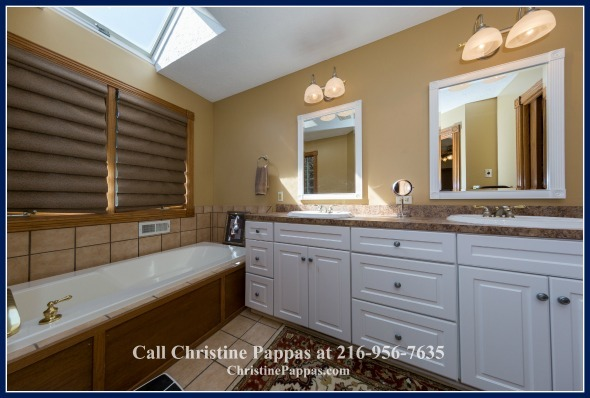 Say goodbye to stress as soon as you take a dip in the relaxing bathtub this sold Kirtland OH home's immaculate master bathroom features!