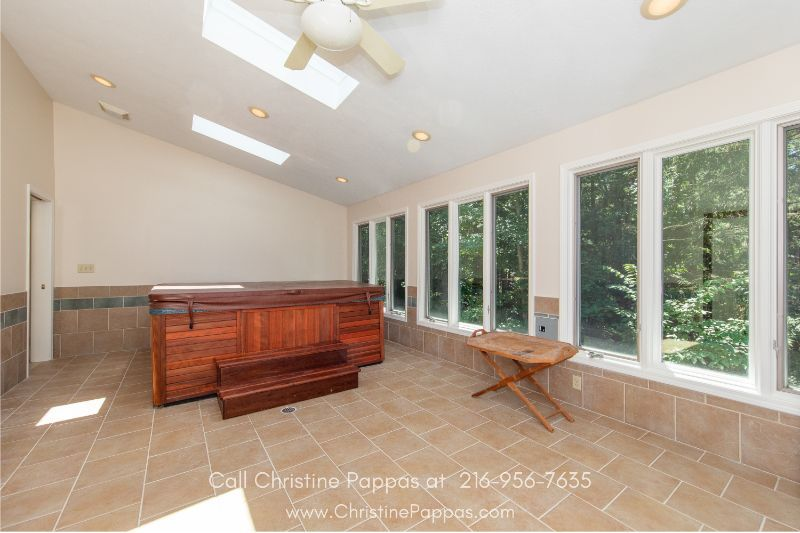 Novelty OH Homes - Enjoy scenic nature views as you relax in the sunroom of this home for sale in Novelty OH.