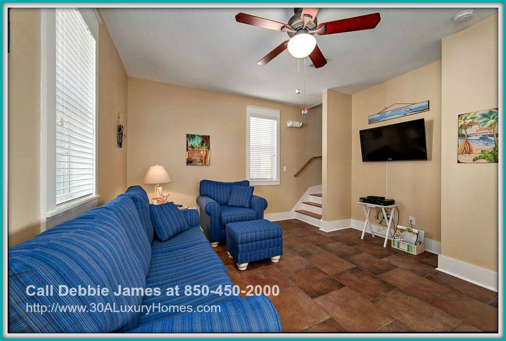 Located on the first floor, the living area in this cottage home for sale in Seagrove Beach FL gives comfort after a day's outdoor activity.