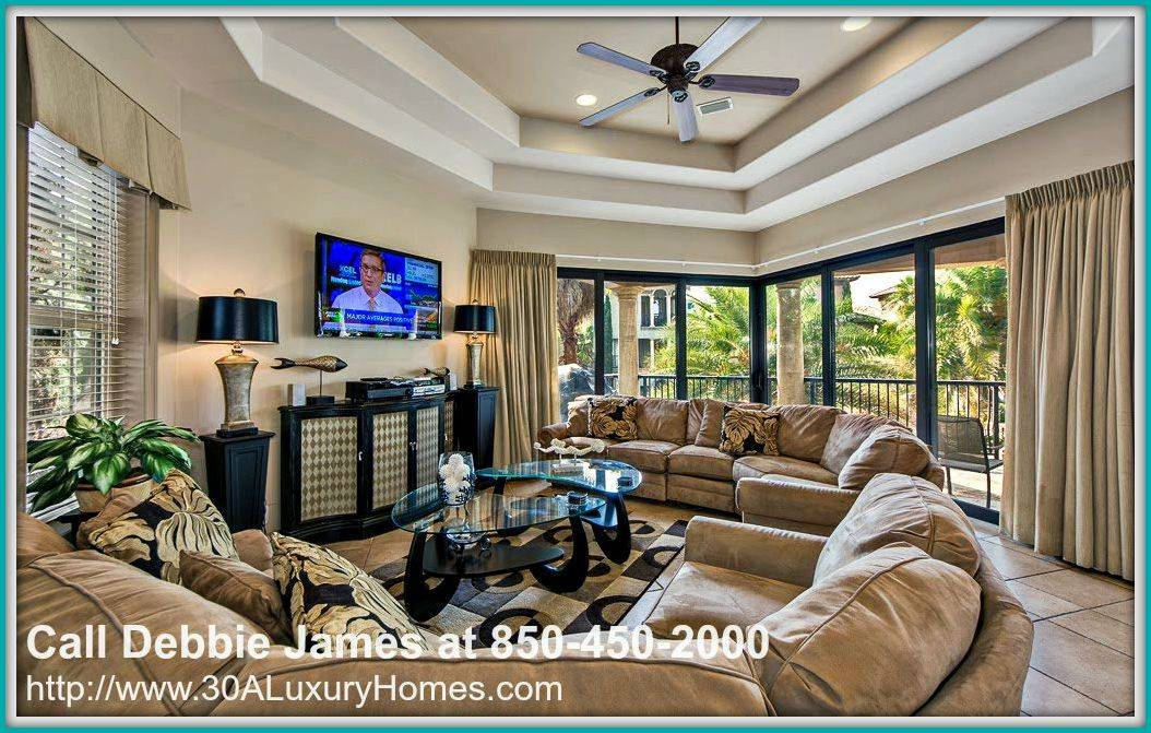 The lovely living room in this gorgeous 4 bedroom Saint Tropez home for sale in Miramar Beach FL is the place to be for a family gathering!