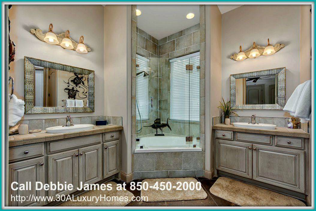 The elegantly designed modern bathroom of this home for sale in Miramar Beach FL sets a relaxing mood for your stressful day.