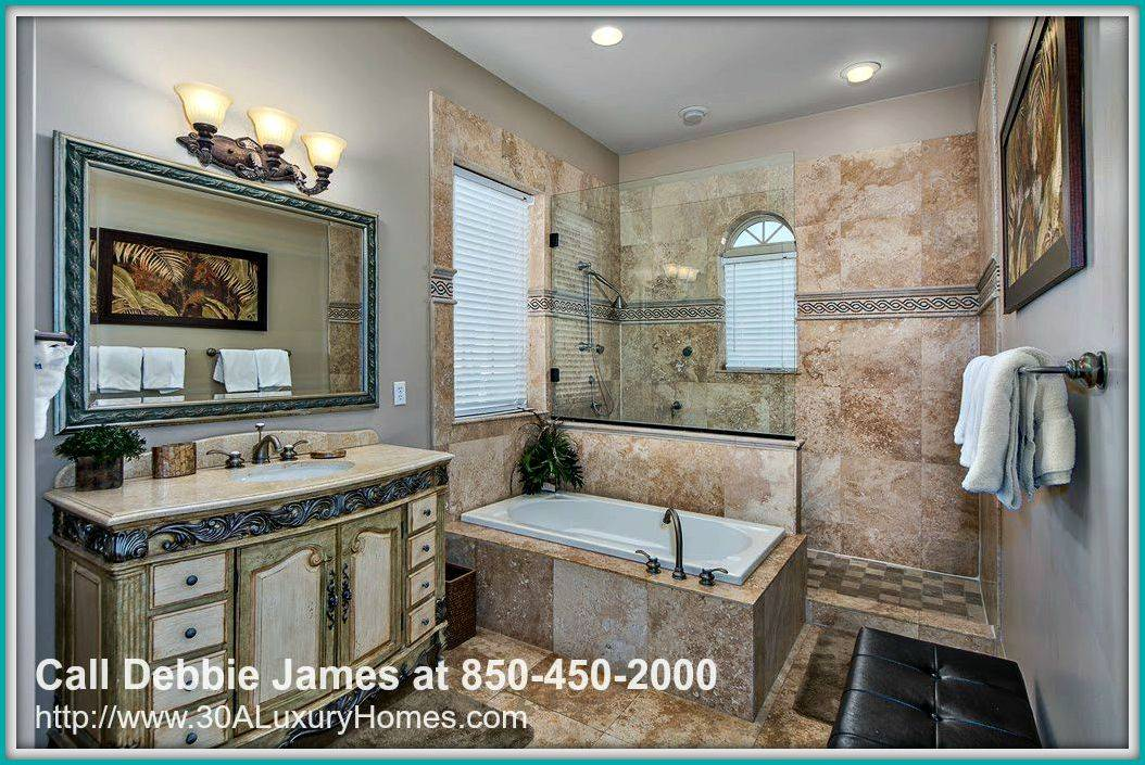 This 4 bedroom Saint Tropez home for sale in Miramar Beach FL has a huge tiled walk-in shower in the master bedroom that provides the perfect venue for a stress-relieving shower.