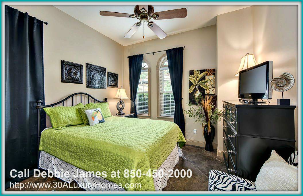 One of the classy large bedrooms of this home for sale in Miramar Beach FL has an immaculate ensuite bath.