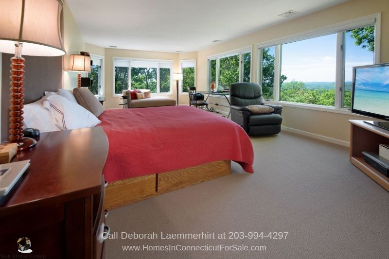 New Fairfield CT Homes - The master bedroom of this New Fairfield property is large and offers panoramic views of the surrounding countryside.