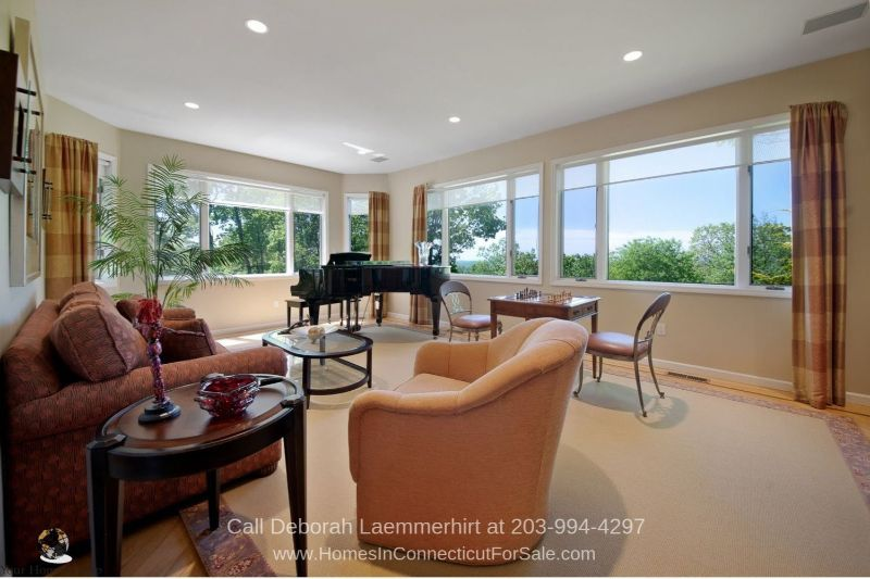 Homes in New Fairfield CT -Light flows freely into the spacious living room of this New Fairfield home.